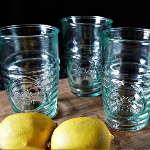 Three glass glasses with lemons