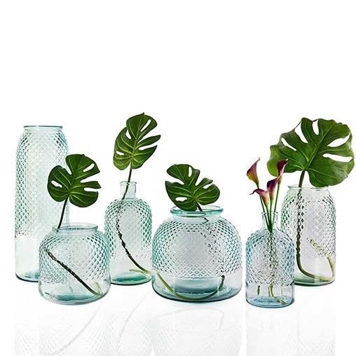 Diamond design glass jars with foliage inside